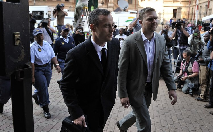 Pistorius, left, goes to court