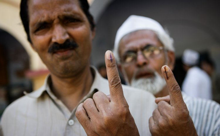 VARANASI, May 12, 2014 (Xinhua) -- People show their marked fingers after casting their votes at a polling station in Varanasi, Uttar Pradesh state, India, May 12, 2014.