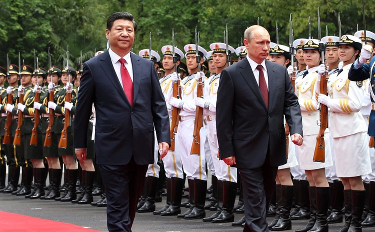 SHANGHAI, May 20, 2014 (Xinhua) -- Chinese President Xi Jinping (front L) holds a welcoming ceremony for Russian President Vladimir Putin (front R) in Shanghai, east China, May 20, 2014.