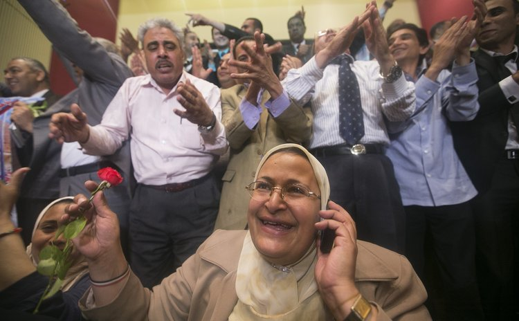 CAIRO, June 3, 2014 (Xinhua) -- Supporters of ex-military chief Abdel-Fattah al-Sisi celebrate after the result of Egyptian presidential election was announced in Cairo, Egypt, June 3, 2014.