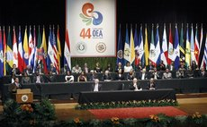 ASUNCION, June 4, 2014 (Xinhua) -- Paraguay's President Horacio Cartes (L, front) delivering a speech during the opening ceremony of the 44th General Assembly of OAS in Asuncion, Paraguay, June 3, 201