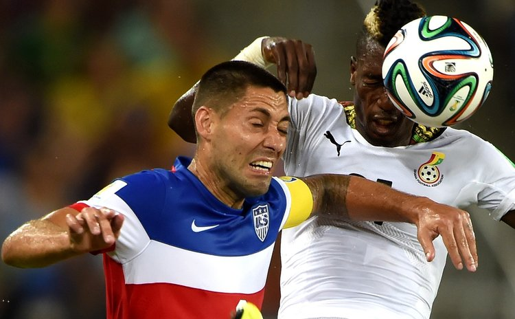 NATAL, June 16, 2014 (Xinhua) -- Ghana's John Boye vies with Clint Dempsey of U.S. during match between Ghana and U.S. of 2014 FIFA World Cup, Brazil, June 16, 2014.