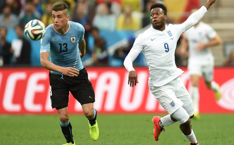 SAO PAULO, June 19, 2014 (Xinhua) -- England's Daniel Sturridge (R) vies with Uruguay's Jose Maria Gimenez during a Group D match between Uruguay and England of 2014 FIFA World Cup