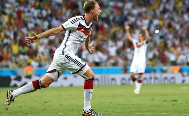 FORTALEZA, June 21, 2014 (Xinhua) -- Benedikt Howedes of Germany celebrates Miroslav Klose's goal during a Group G match between Germany and Ghana of 2014 FIFA World Cup