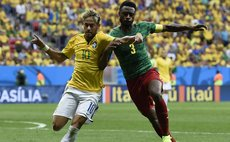 BRASILIA, June 23, 2014 (Xinhua) -- Brazil's Neymar (L) vies with Cameroon's Nicolas Nkoulou during a Group A match between Cameroon and Brazil of 2014 FIFA World Cup
