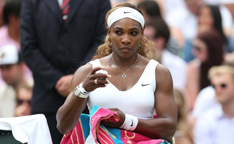 LONDON, June 26, 2014 (Xinhua) -- U.S. player Serena Williams rests during the women's singles second round match against South Africa's Chanelle Scheepers at the 2014 Wimbledon Championships