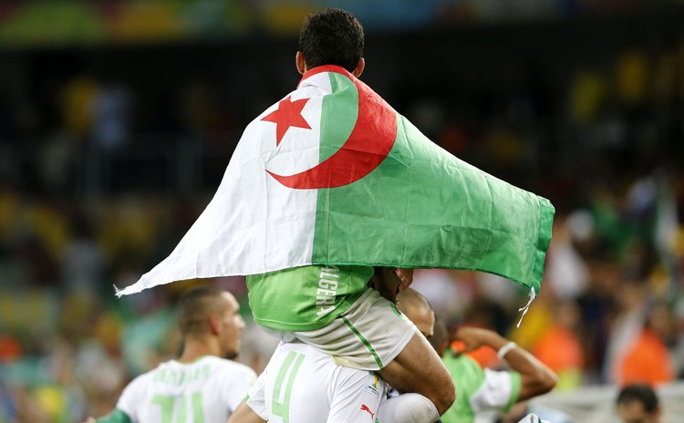 CURITIBA, June 26, 2014 (Xinhua) -- Algeria's players celebrate after a Group H match between Algeria and Russia of 2014 FIFA World Cup at the Arena da Baixada Stadium in Curitiba, Brazil, June 26