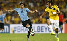 RIO DE JANEIRO, June 28, 2014 (Xinhua) -- Uruguay's Edinson Cavani (L) vies with Colombia's Mario Yepes during a Round of 16 match between Colombia and Uruguay of 2014 FIFA World Cup