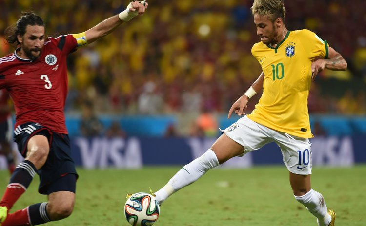 FORTALEZA, July 4, 2014 (Xinhua) -- Colombia's Mario Yepes (L) vies with Brazil's Neymar during a quarter-finals match between Brazil and Colombia of 2014 FIFA World Cup