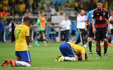 BELO HORIZONTE, July 8, 2014 (Xinhua) -- Brazil's David Luiz (2nd L) and Luiz Gustavo (1st L) react after a semifinal match between Brazil and Germany of 2014 FIFA World Cup