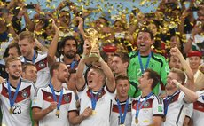 RIO DE JANEIRO, July 13, 2014 (Xinhua) -- Germany's Bastian Schweinsteiger (C, front) holds the FIFA World Cup trophy after the final match between Germany and Argentina of 2014 FIFA World Cup