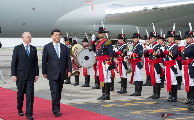 BUENOS AIRES, July 18, 2014 (Xinhua) -- Chinese President Xi Jinping (2nd L) is welcomed by Argentinian Foreign Minister Hector Timerman (1st L) in Buenos Aires, Argentina, July 18, 2014