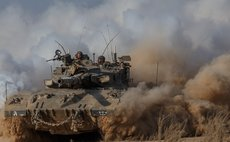 GAZA BORDER, July 28, 2014 (Xinhua) -- A Merkava tank rolls in southern Israel near the border with Gaza, on July 27, 2014