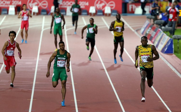 GLASGOW, Aug. 2, 2014 (Xinhua) -- Usian Bolt (1st R) of Jamaica competes during the men's 4X100m relay round 1 of Athletics at the 2014 Glasgow Commonwealth Games