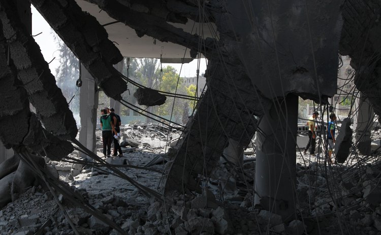 GAZA, Aug. 2, 2014 (Xinhua) -- Palestinians search on the debris of a destroyed mosque after an Israeli airstrike in Gaza City, on Aug. 2, 2014.