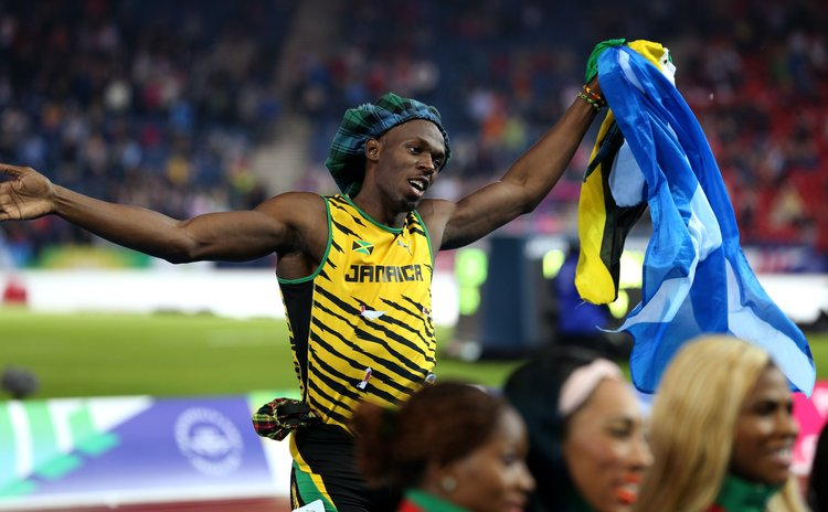 GLASGOW, Aug. 3, 2014 (Xinhua) -- Usain Bolt of Jamaica reacts after the men's 4X100m relay final of Athletics at the 2014 Glasgow Commonwealth Games, Scotland on Aug. 2, 2014.