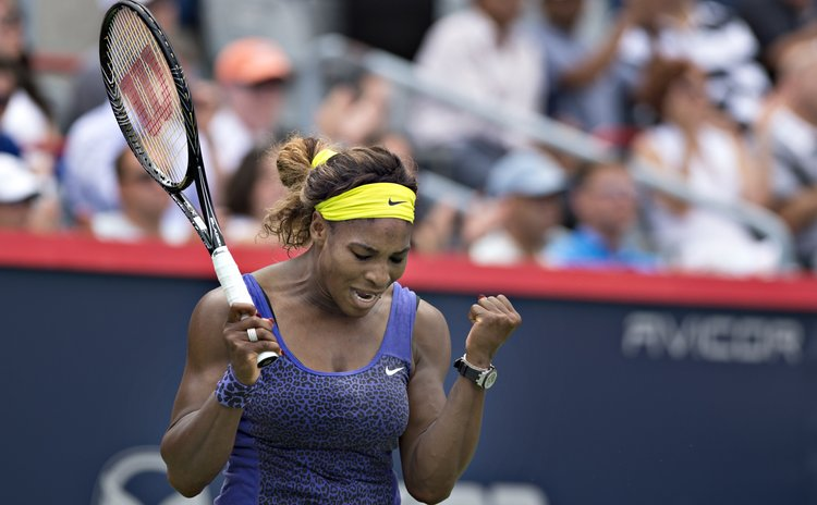 MONTREAL , Aug. 9, 2014 (Xinhua) -- Serena Williams of the United States reacts after winning the quarterfinal match against Caroline Wozniacki of Denmark during the Rogers Cup in Montreal, Canada.
