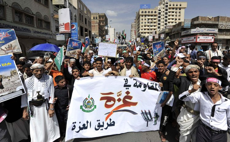 SANAA, Aug. 9, 2014 (Xinhua) -- Yemeni protesters shout slogans during a protest against Israeli offensive on Gaza Strip in Sanaa, Yemen, on August 9, 2014.
