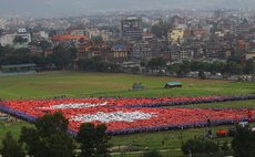"""KATHMANDU, Aug. 23, 2014 (Xinhua) -- Nepalese people participate in breaking the Guiness World Record of """"Largest Human National Flag"""" in Kathmandu, Nepal, Aug. 23, 2014."""