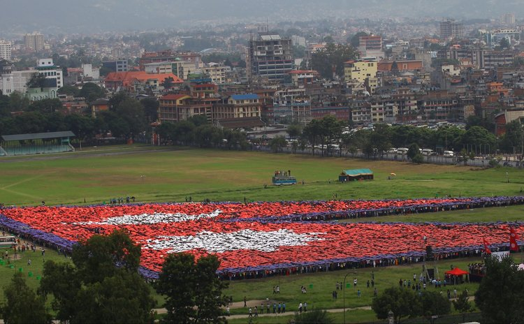 "KATHMANDU, Aug. 23, 2014 (Xinhua) -- Nepalese people participate in breaking the Guiness World Record of ""Largest Human National Flag"" in Kathmandu, Nepal, Aug. 23, 2014."