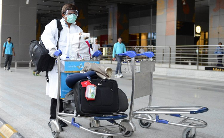 NEW DELHI, Aug. 27, 2014 (Xinhua) -- A passenger, who did not pass the preliminary screening for the Ebola virus, leaves the Delhi International Airport to Ram Manohar Lohia Hospital