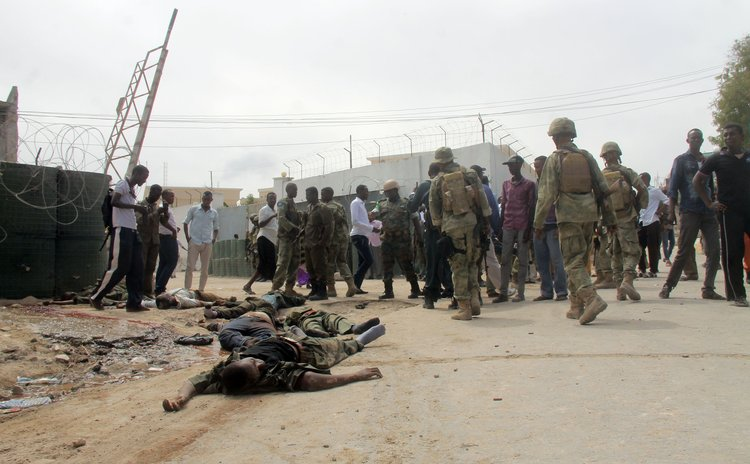 MOGADISHU, Sept. 1, 2014 (Xinhua) -- Bodies of suspected Al Shabaab militants lay on the ground after a bomb explosion in Mogadishu, capital of Somalia, Aug. 31, 2014.
