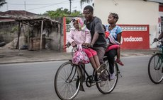 "QUELIMANE (MOZAMBIQUE), Sept. 12, 2014 (Xinhua) -- Photo taken Aug. 31, 2014 shows a ""bicycle taxi"" cyclist carrying passengers in Quelimane, capital of Zambezia, central province of Mozambique"