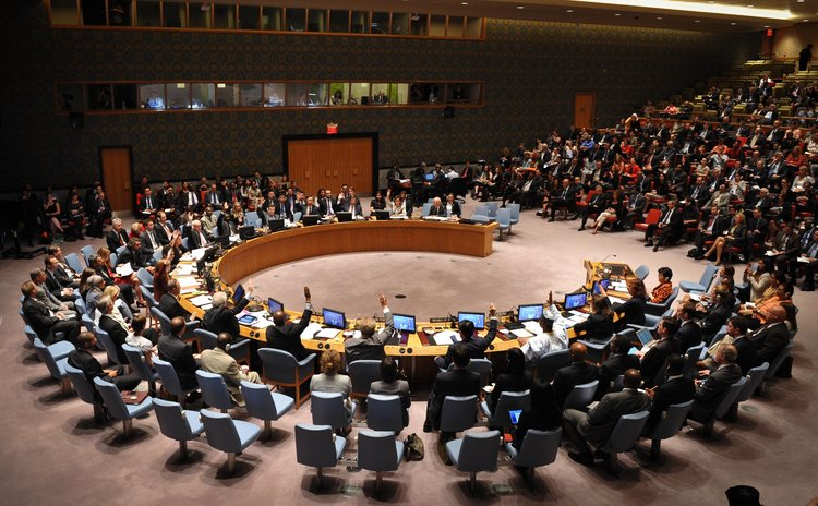 NEW YORK, Sept. 18, 2014 (Xinhua) -- The UN Security Council votes on a draft resolution during the council's emergency meeting on Ebola outbreak, at the UN headquarters in New York, on Sept. 18, 2014