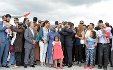 ANKARA, Sep. 20, 2014 (Xinhua) -- Released Turkish hostages meet with their families at the Ankara Esenboga Airport, Turkey, Sept. 20, 2014.