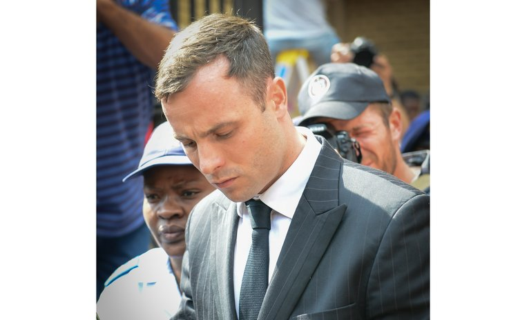 PRETORIA, Oct. 13, 2014 (Xinhua) -- Oscar Pistorius leaves the North Gauteng High Court in Pretoria, South Africa, on Oct. 13, 2014