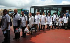 MONROVIA, Oct. 22, 2014 (Xinhua) -- Cuban health care workers arrive at the Roberts International Airport in Monrovia, capital of Liberia, on Oct. 22, 2014.