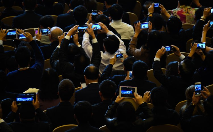 BEIJING, Nov. 10, 2014 (Xinhua) -- Guests take pictures of U.S. President Barack Obama delivering a keynote speech at the 2014 APEC Summit in Beijing, capital of China, Nov. 10, 2014.