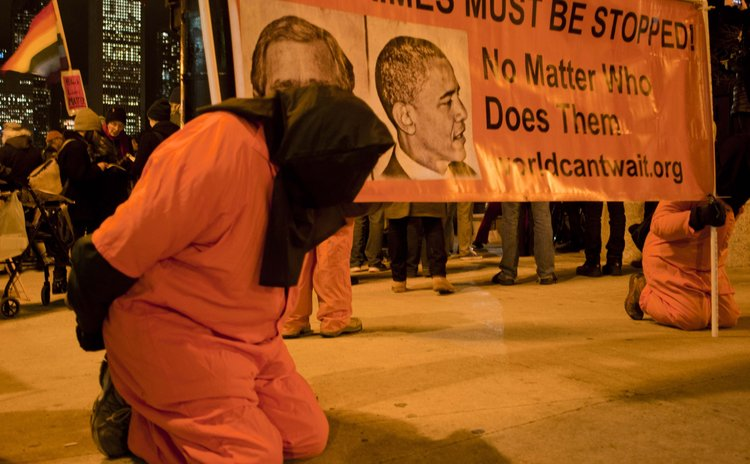 CHICAGO, Dec. 11 (Xinhua) -- Activists are dressed up as prisoners to protest American torture in Chicago on Dec.10, 2014