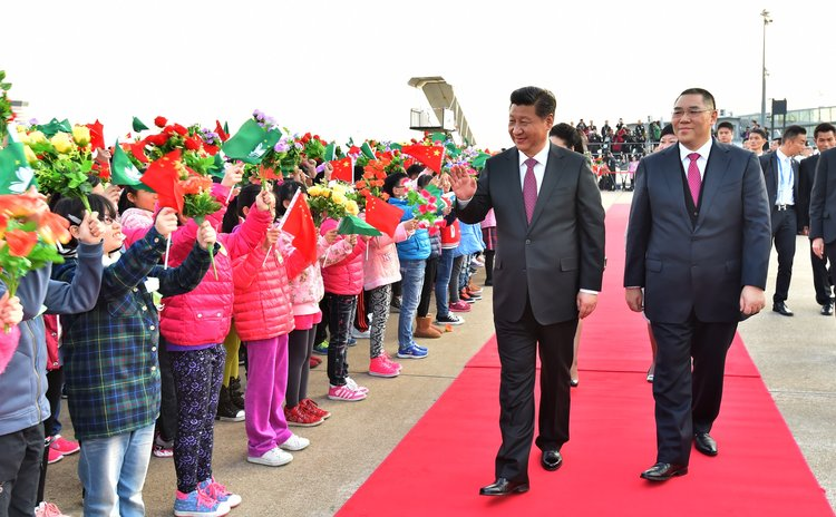 MACAO, Dec. 20, 2014 (Xinhua) -- Chinese President Xi Jinping waves to people at the airport in Macao, south China, on Dec. 20, 2014.
