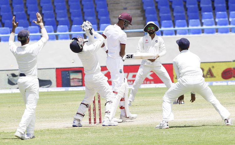 India celebrate taking another West Indies wicket