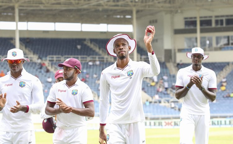 Chase leads WI team off the field after taking a five-for