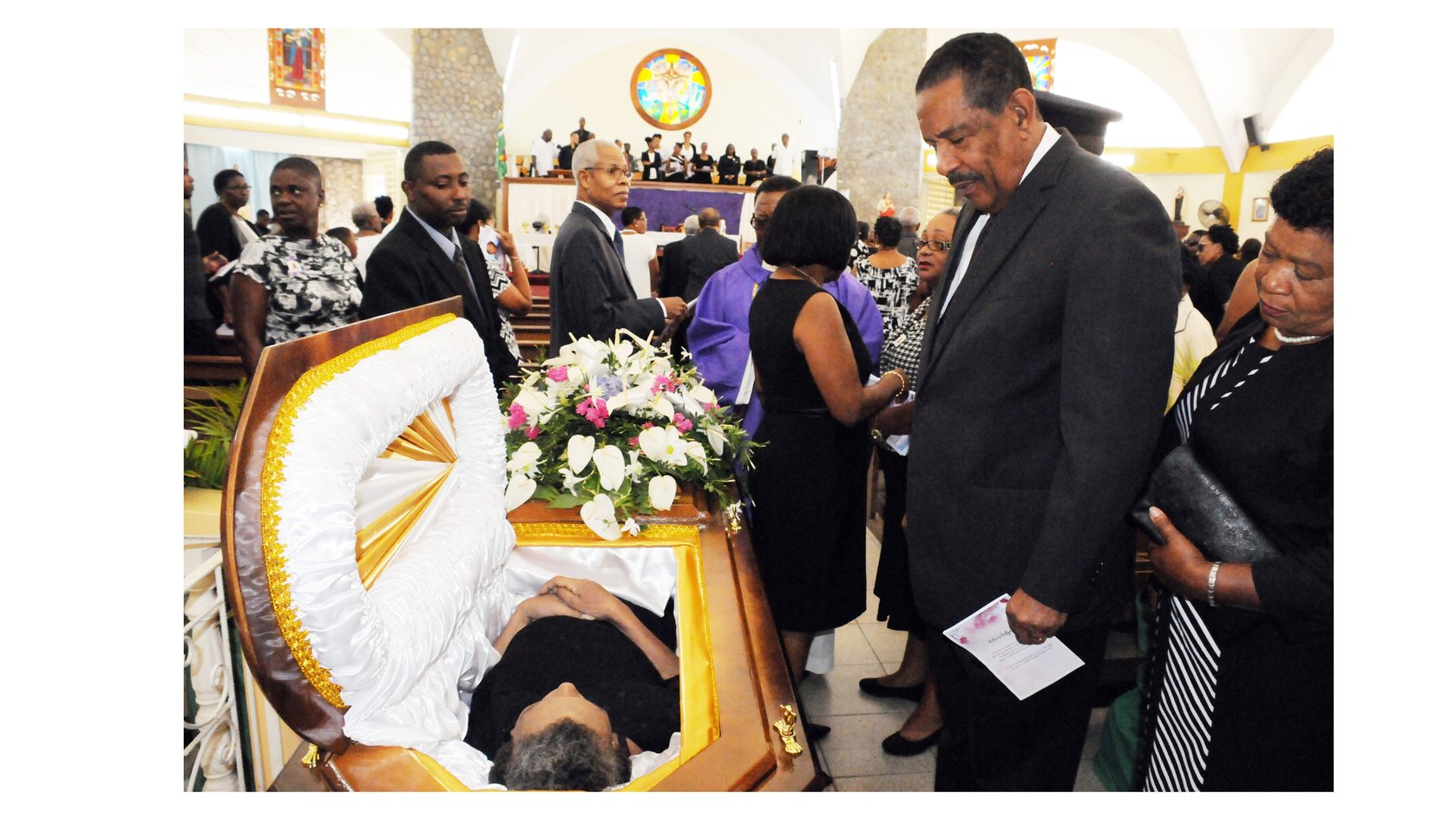President Charles Savarin at the funeral of Alex Phillip, the late Clerk of the House of Assembly