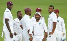 Bishoo (with hat) celebrates 8 wicket haul