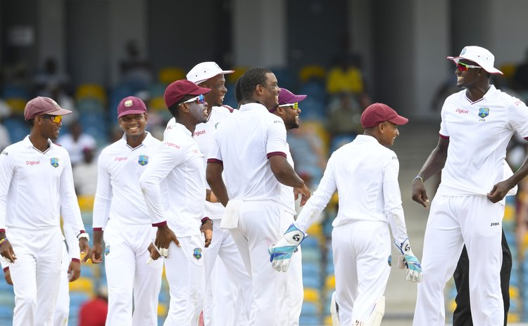 Happy Windies after beating Pakistan in Barbados