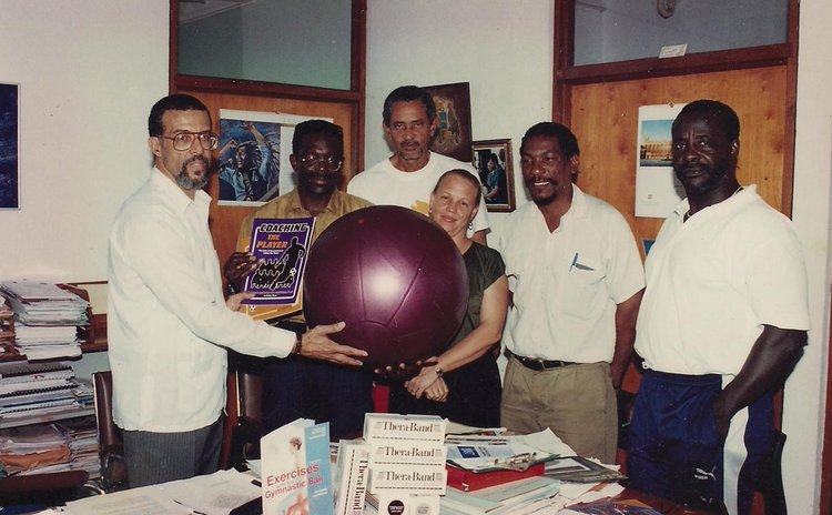 Ron Green (L), then Minister for Education, Youth & Sports, accompanied by DOC and Sports Officials, receiving sports equipment from Dr. Jenny Allport