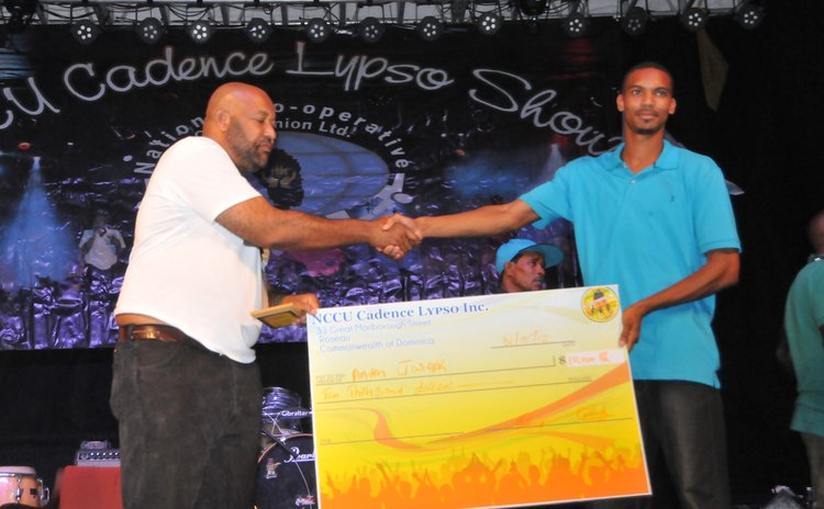NCCU president Dexter Ducreay ,left, shakes hands with Anton Joseph, winner of the 4th Cadencelypso competition