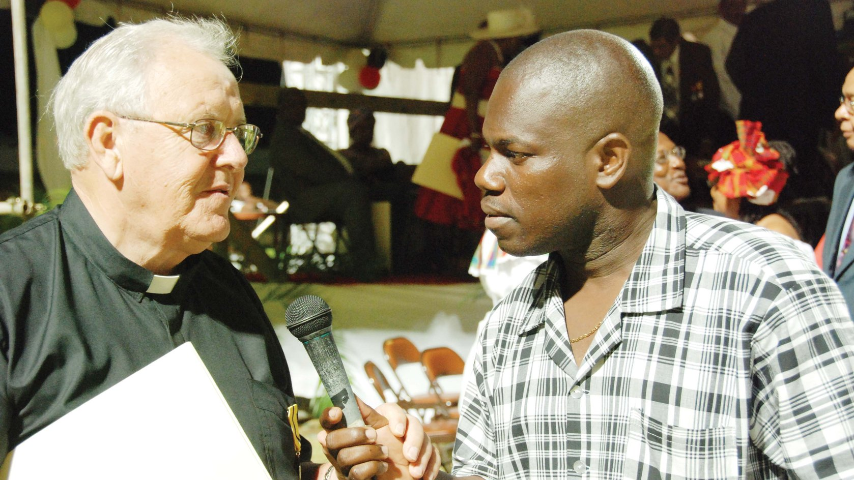 Sun's Person of the Year 2108 here interviews the late Catholic Priest Father Charles in 2006