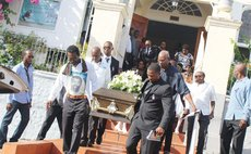 Relatives and friends carry the coffin of Alec Gage to his final resting place