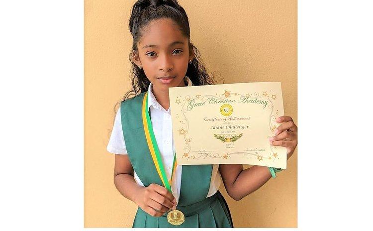 Aliane Challenger shows her awards