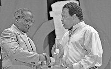 President Liverpool hands Golden Drum trophy to Allan Moise