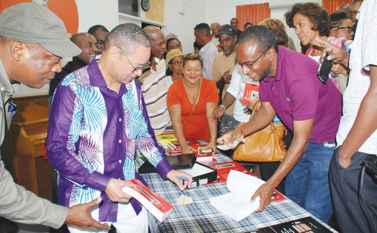 Dr. Irving Andre signs book at the book launch