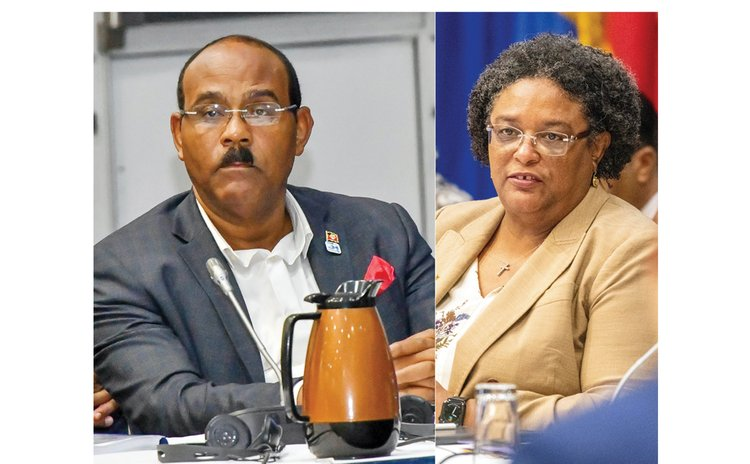 In photo Antigua's Browne and Barbados's Mortley