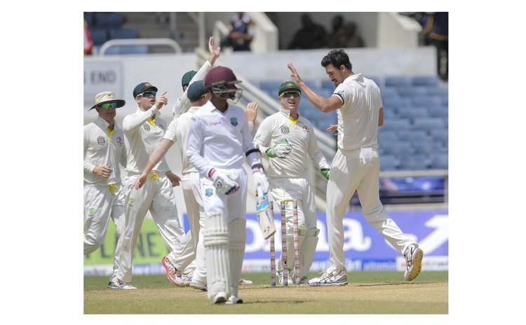 Australia celebrate at the end of the West Indies innings