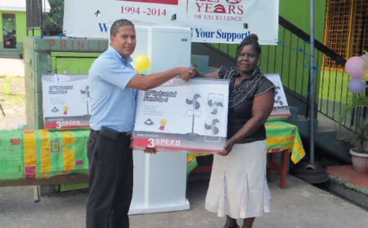 Auto Trade official make presentation to Massacre school
