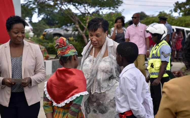 Baroness Patricia Scotland speaks with pupils of the Baroness Scotland primary School in Vielle Case during a renaming of the school function (Photo: Office of the Prime Minister)